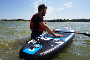 Man using a Riber inflatable SUP
