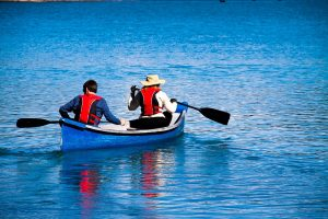 Two people in a canoe part of a club