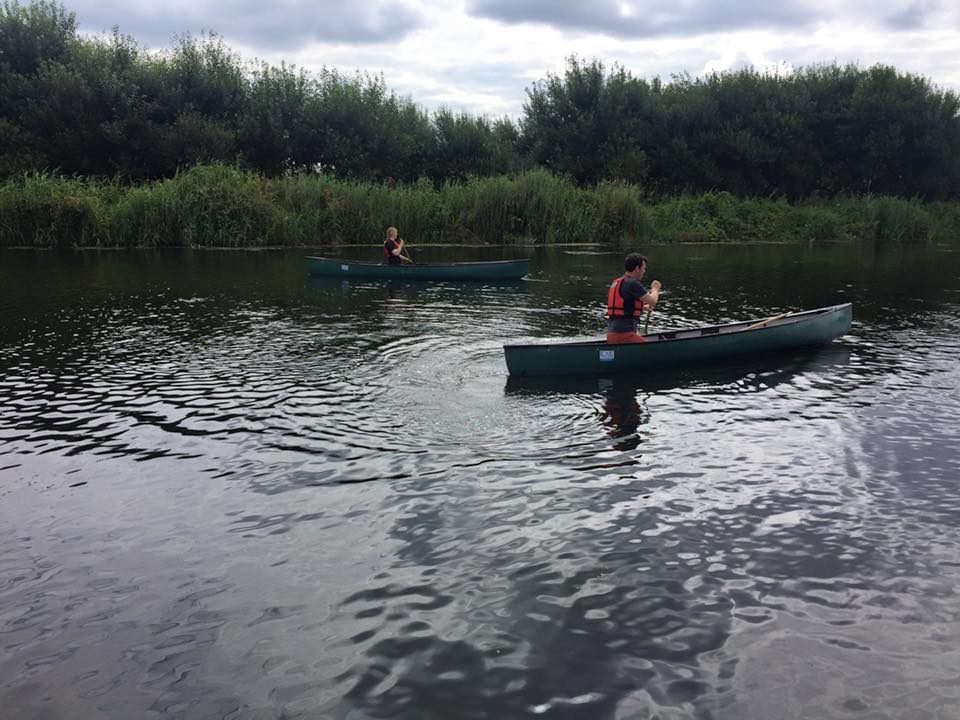 People canoeing with riber canoes