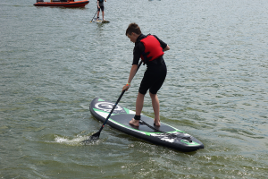 Person paddleboarding on a Riber iSUP