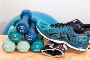 Weights and trainer ready for a workout
