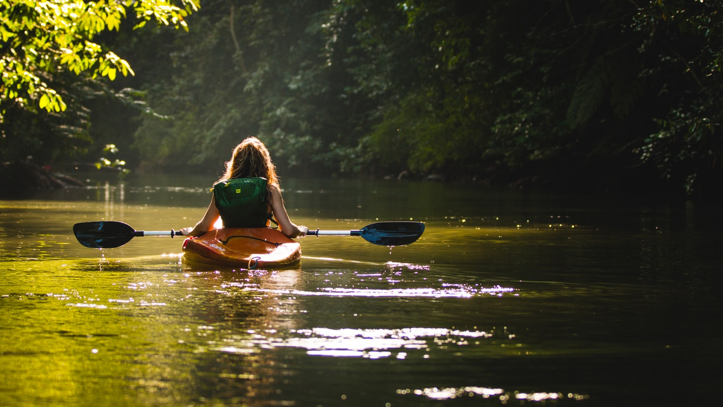 Woman kayaking solo