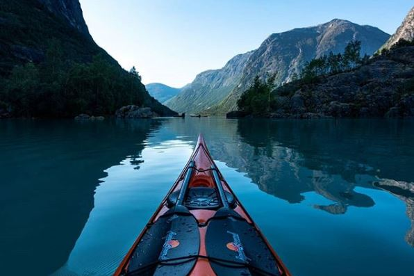 Tomasz Furmanek kayaking in Lovatnet in Stryn, Norway